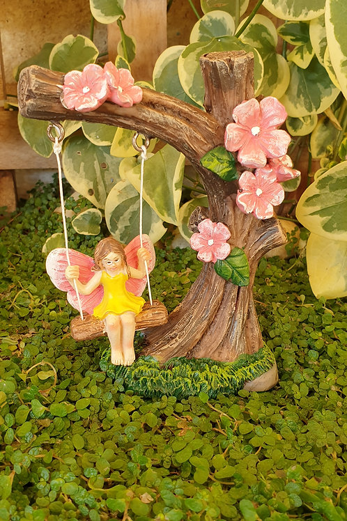 Garden swing with fairy
