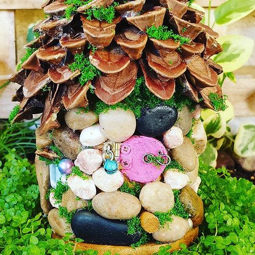 Woodland stone & pinecone house