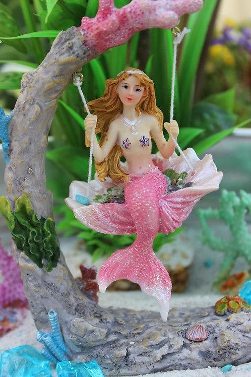 Mermaid on a shell swing