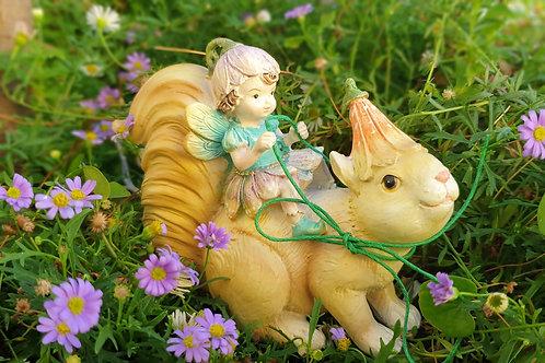 Sweetpea fairy riding squirrel