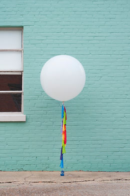 white giant rainbow tassel portrait.jpg