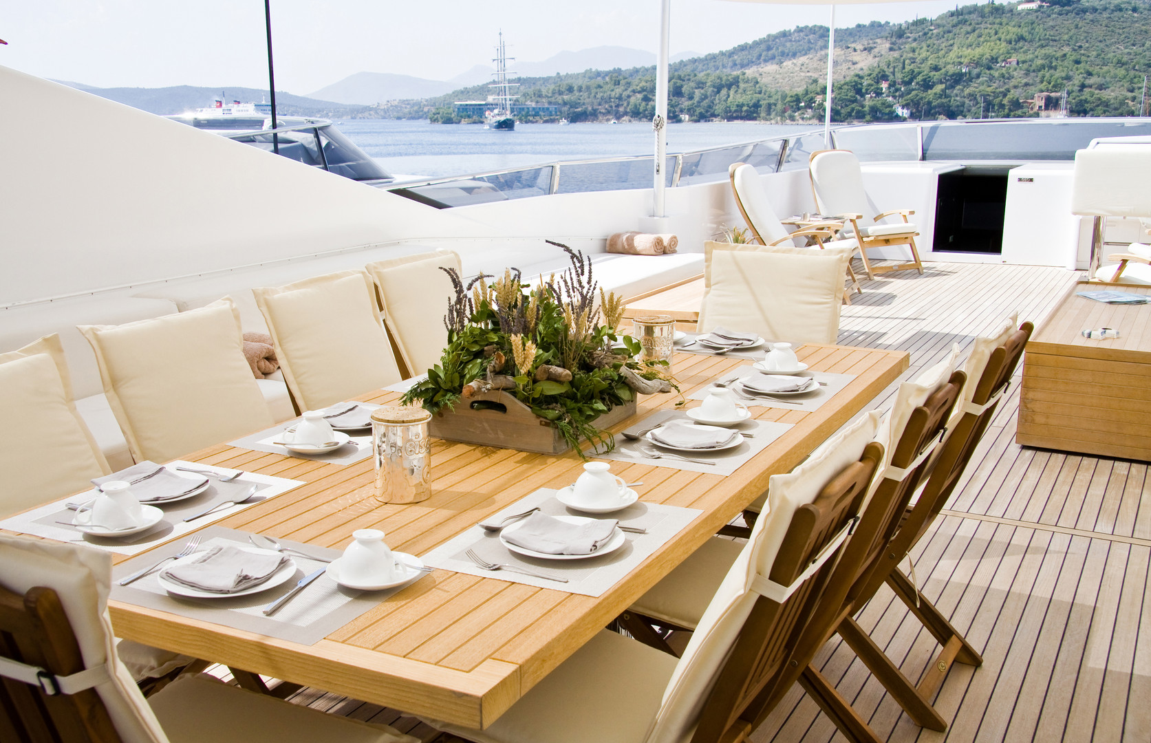Summer day yacht deck with served table.