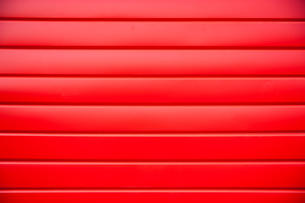 House siding. Red plastic panel siding t
