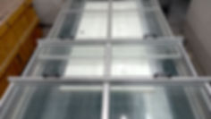 door under glass on belt.jpg
