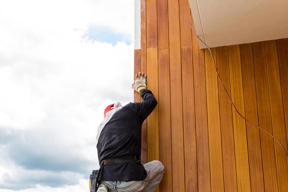 Men build siding Fiber Cement Board on w