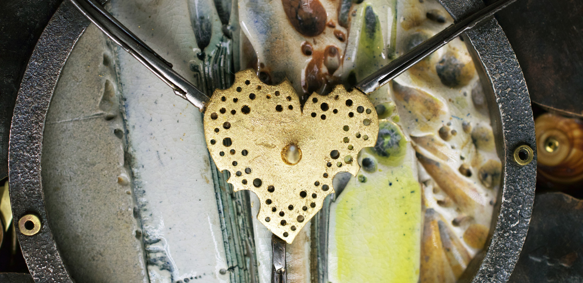 Closer detail of tattered heart: 64 holes commemorate the age of the person memorialized in this commission.