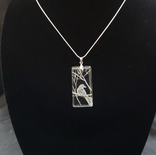 glass crow necklace