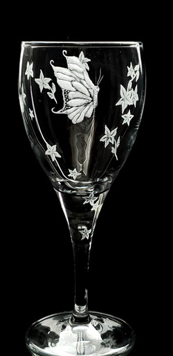 butterflies on wine glass