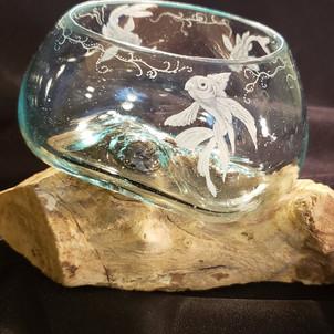 glass bowl formed to teak wood