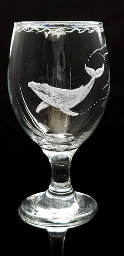 Humpback whale on stout/drink glass