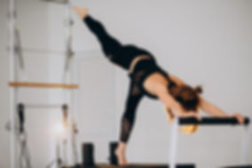 woman-doing-pilates-on-a-reformer_1303-1