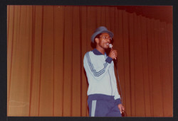 04 Linton Kwesi Johnson (performing) at Bogle-L'Ouverture Publications 10th Anniversary event. 1979.