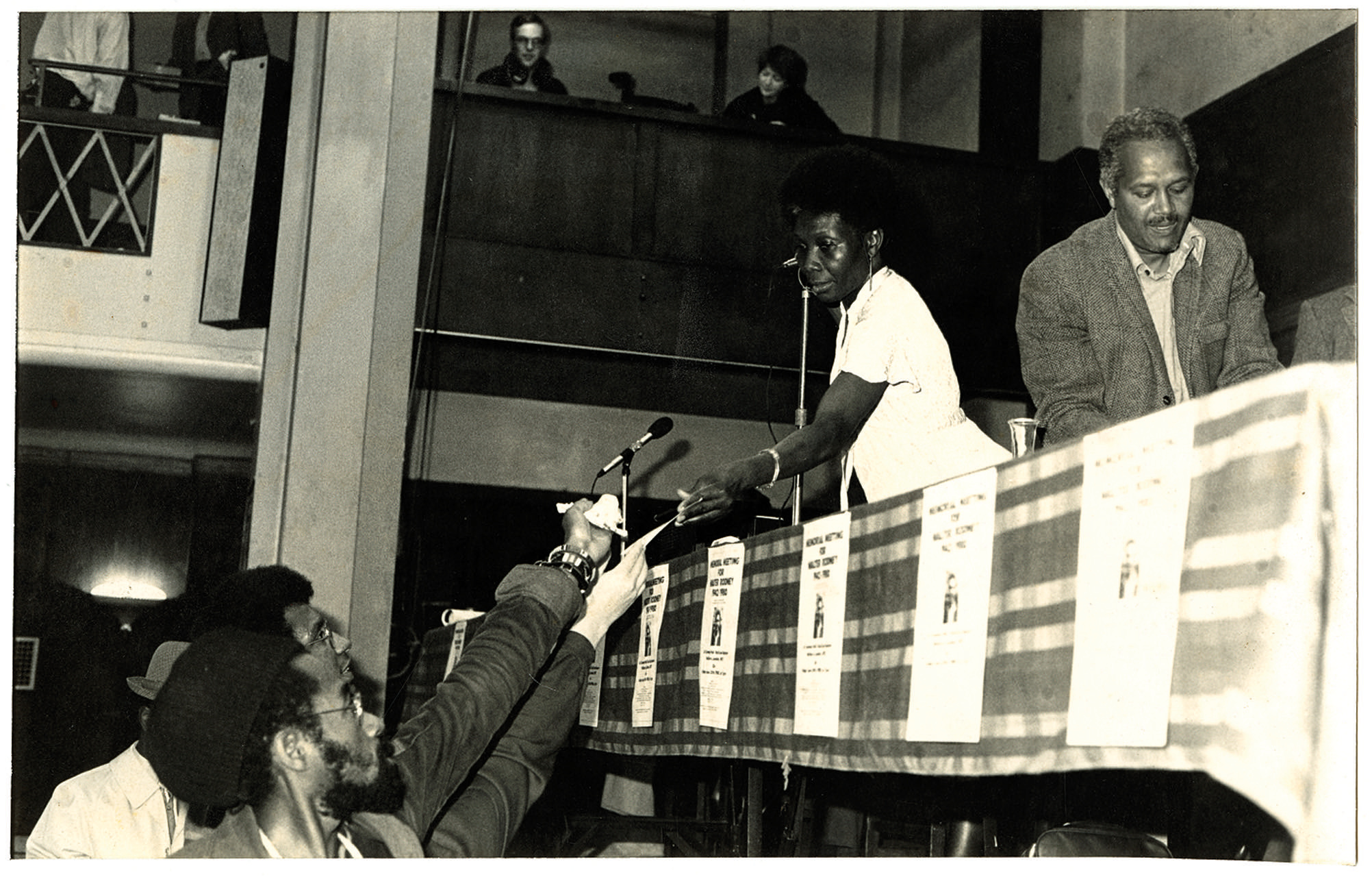 _23 L to R - Armet Francis (below), Jessica Huntley _ John La Rose (on stage) at Walter Rodney Memor