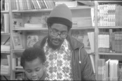 _08 Accabre Huntley _ Walter Rodney in Bogle-L'Ouverture Bookshop. c1970s. Huntley Archives at Londo