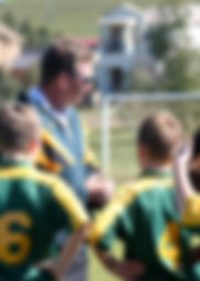 experienced coaches working with children