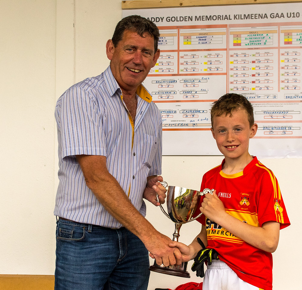 Hugh Golden presenting the Cup to the Captain of the Castlebar team.