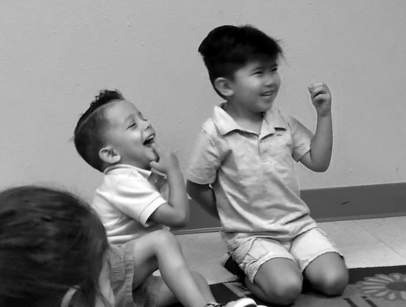 Children laughing during music class with Prelude Music Foundation