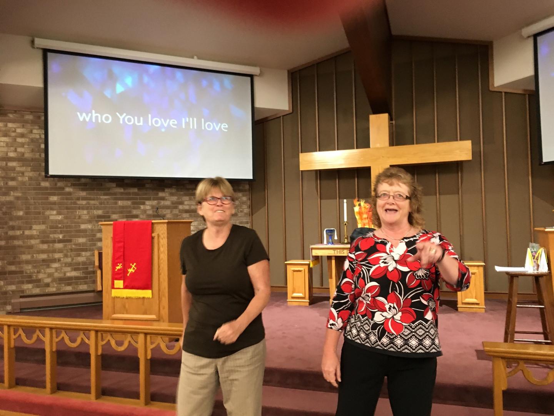 deb and lisa dancing to praise hymn.jpg