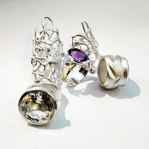 Unusual avant garde silver rings with amethyst and rock quartz