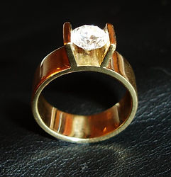 Wide gold and floating diamond engagement wedding ring