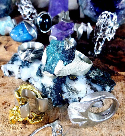 Raw gemstone silver rings and melted gold