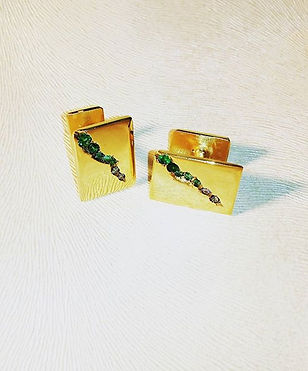Gold and emerald cufflinks by Ibex Gold