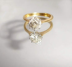 Gold and solitaire diamond engagement ring