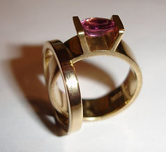 Gold and pink sapphire engagement ring and wedding band