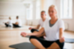 senior-man-woman-meditating-together_23-