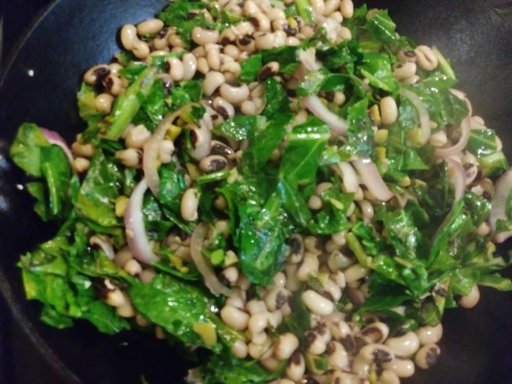 black eyed peas added to pan