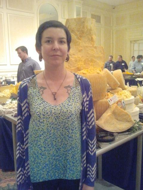 Chef Chelsea Moran in front of cheese mountain