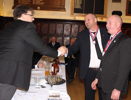 AsstPGM John Thompson congratulating Marquis of Granby Lodge 124's Michael Dunn and John Butterfield.