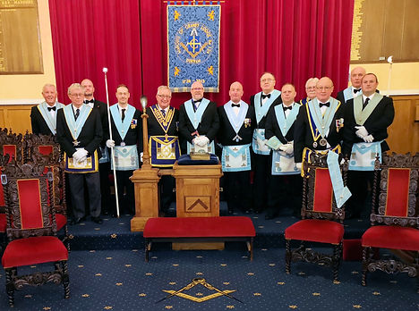 Group photo of the Master & Officers of Marquis of Granby Lodge 124 & WBro Phil Rann PPJGW,PAGDC