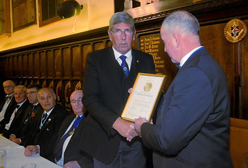 Provincial Grand Master John Arthur presents a framed certificate to WBro John Butterfield to mark the lodge reaching 'Gold Standard' in the Durham 2021 Festival.