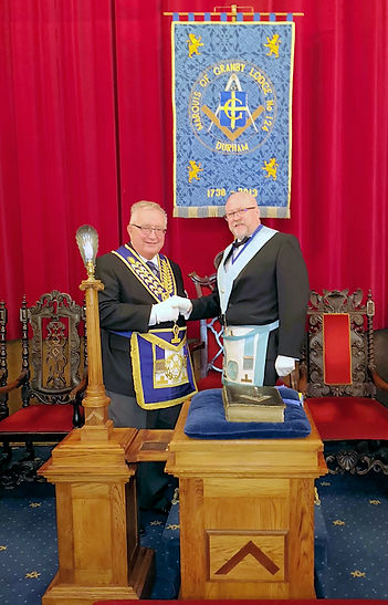 WBro Brian Radcliffe & WBro Philip Rann PPJGW,PAGDC after receiving cheques for the Durham 2021 festival & TLC Teddies