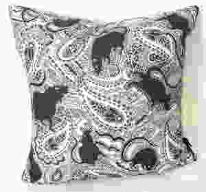 the famous rat cushion with black rats on a white background