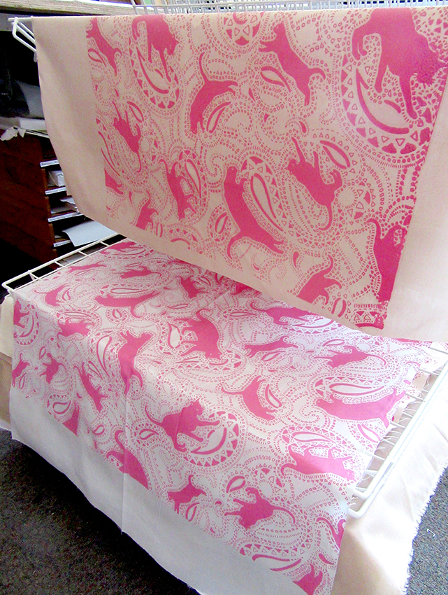 pink & white cat prints drying