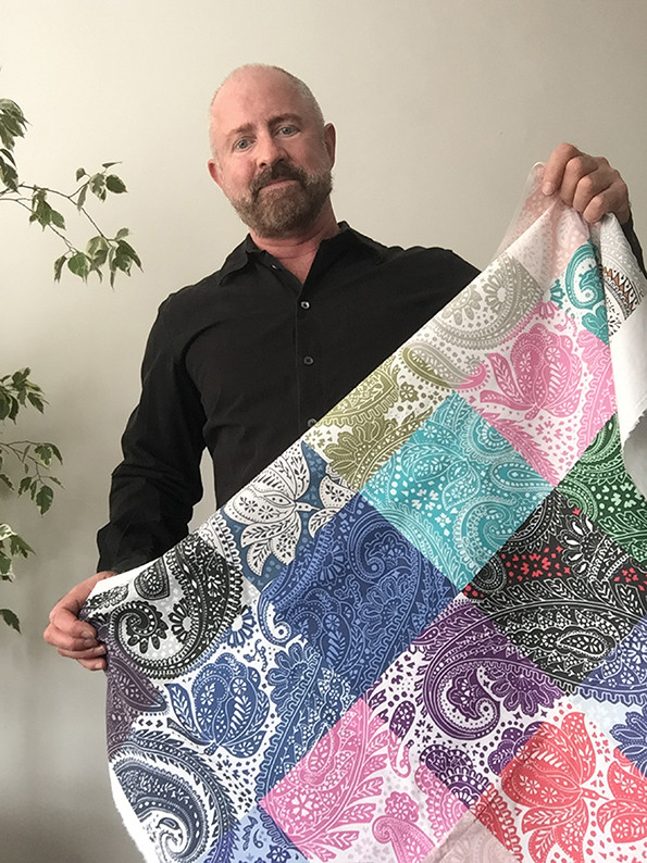 Textile-designer-Patrick-Moriarty-holdin