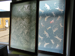 two silk-screens drying in sunlight