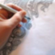 creating a paisley print design by hand using pencil and ink