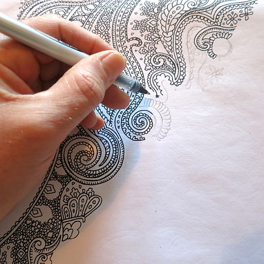 designer Patrick Moriarty is drawing one of his popular paisley patterns
