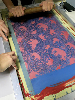 2 printers printing an elephant pattern in the print room