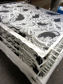 rat pattern printed fabric by Paisley Power in the print room on a drying rack.jpg