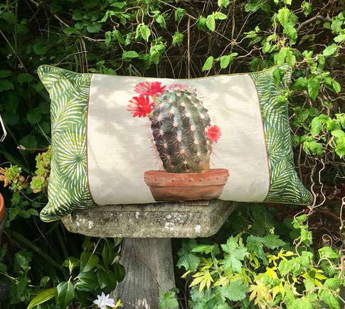 cactus cushion with palm leaf borders