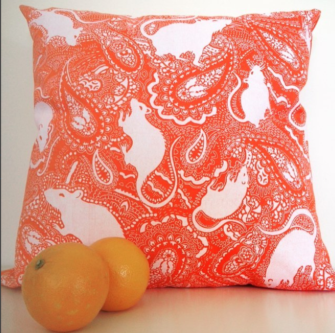 orange-paisley-cushion-with-white-rat-pattern-designed-by-Paisley-Power
