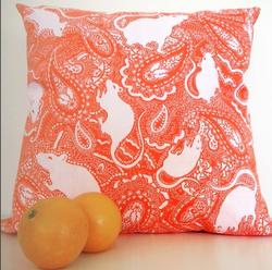 orange-paisley-cushion-with-white-rat-pattern-designed-by-Paisley-Power
