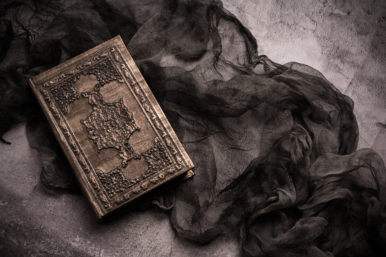 Old book with spells and magic wand on g