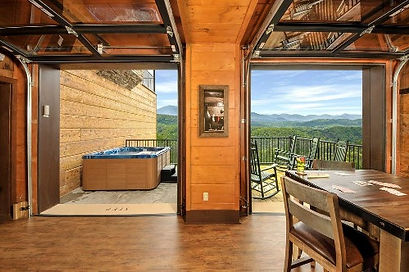 Cabin with elevator Pigeon Forge, TN, Skyview Mansion view of hot tub and deck