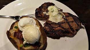 Ribeye steak and loaded potatoe