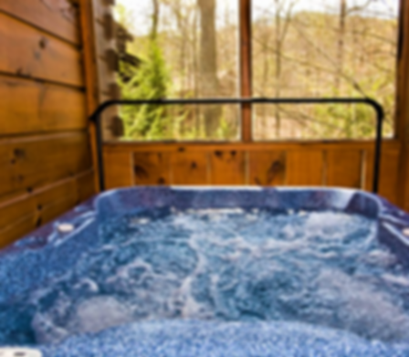 Hot tub on the porch of a cabin in the Smoky Mountains